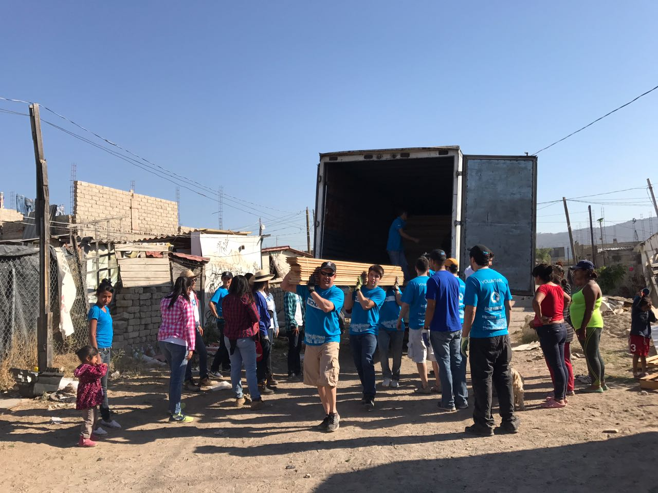 Arpin Strong, helps unload a truck while building homes for the homeless in Guadalajara Mexico.