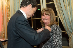 Joelle receives the Chevalier of the Legion of Honour from Geoffroy Roux de Bezieux
